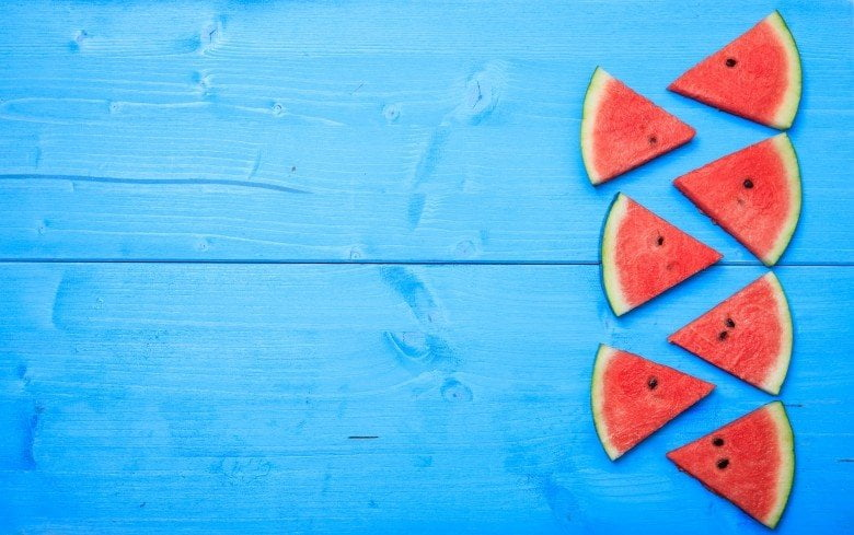 A photograph of couple of watermelon pieces