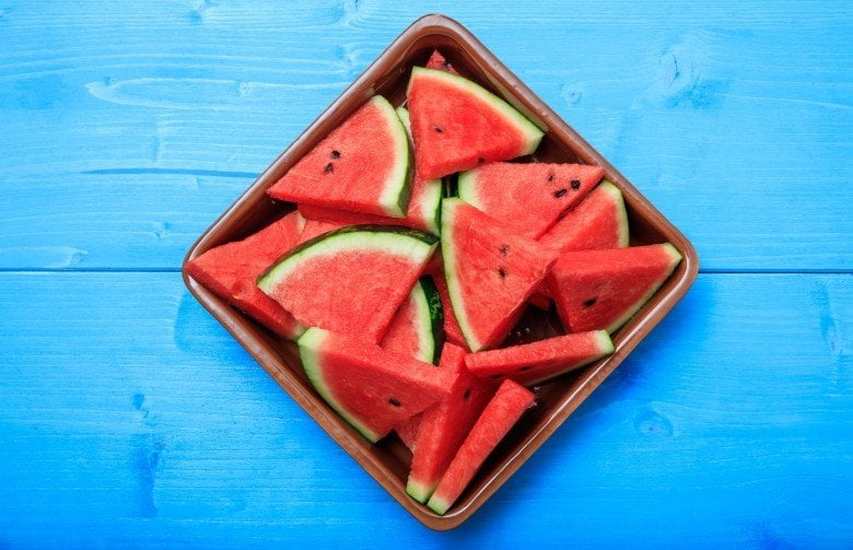 A bunch of watermelon pieces on a tray
