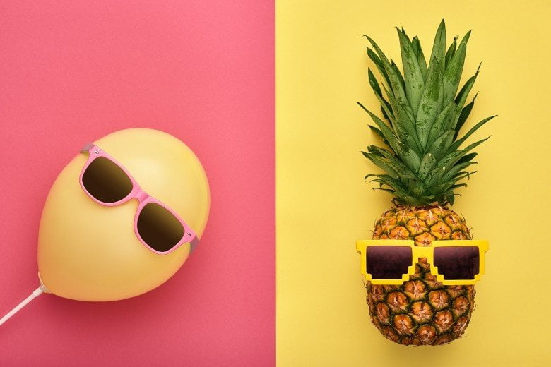 An image showing a ballon and pineapple with sunglases