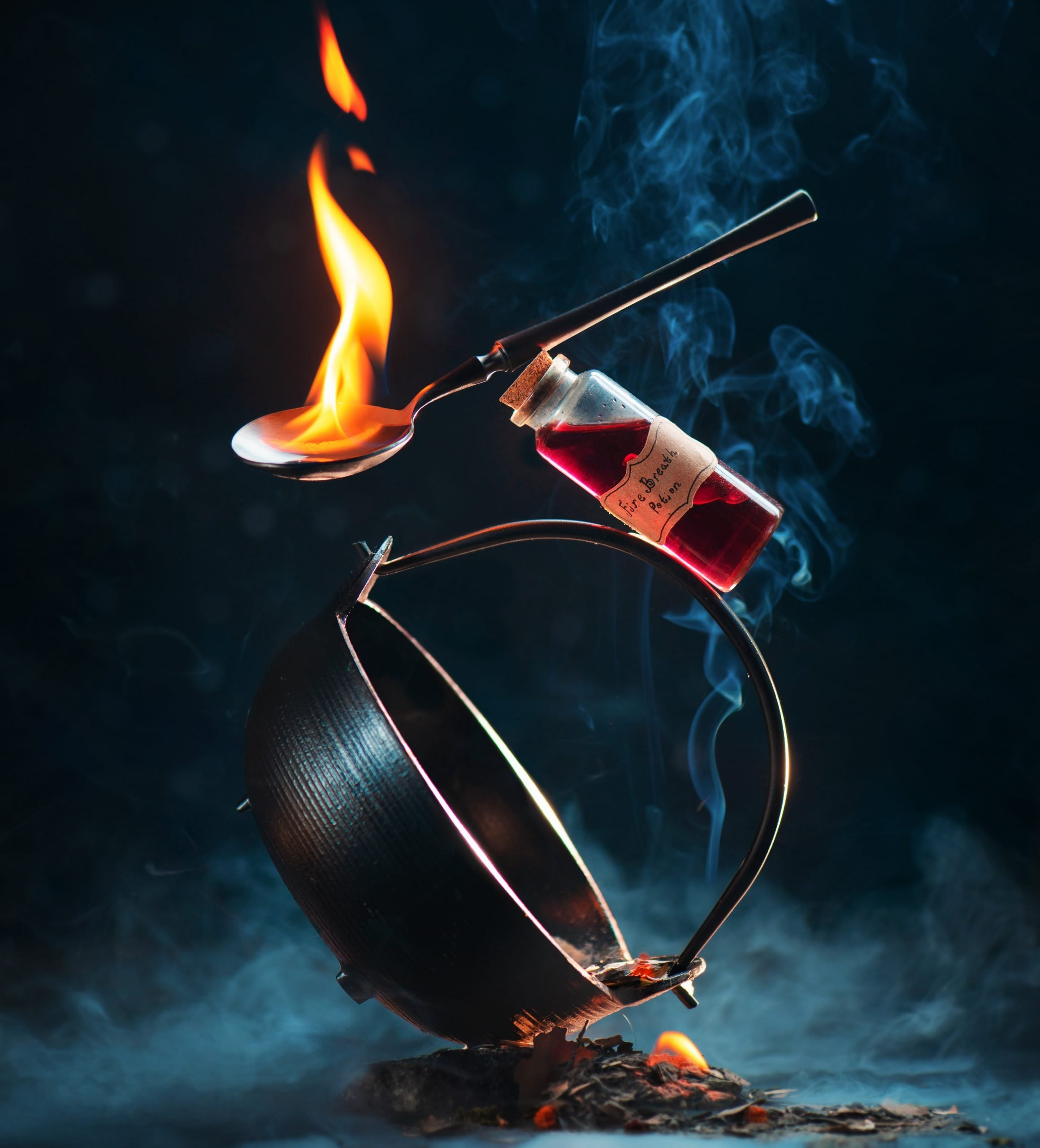 An image of a caludron and fire sybolizing balance.